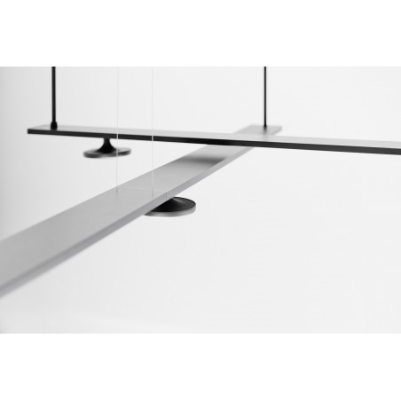 Create unique lighting systems with two or more suspended tracks.